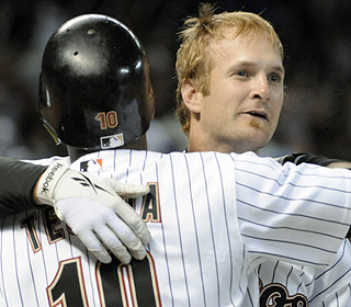 Miguel Tejada is the first one with an embrace for Jeff Keppinger after the walk-off single. (AP)