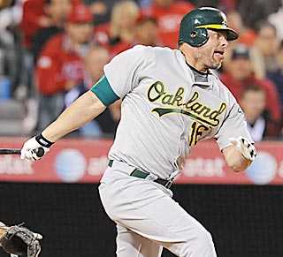 Jason Giambi strokes his first base hit since returning to the A's, then gets two more.  (Getty Images)