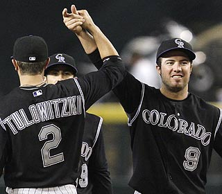 Troy Tulowitzki and Ian Stewart enjoy the Rockies' first series victory against Arizona in two years.  (AP)