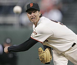 Randy Johnson's debut with the Giants goes well until Yovani Gallardo's home run in the fifth inning.  (AP)