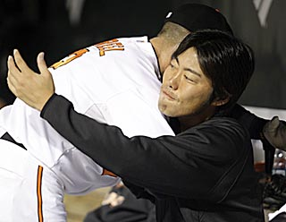 Ryan Freel hugs right-hander Koji Uehara, who thwarts the mighty Yankees in his major league debut.  (AP)
