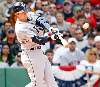 Evan Longoria has three hits and crushes a two-run homer, one of three Dice-K served up.  (Getty Images)