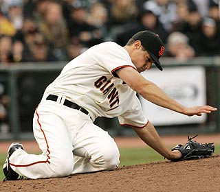 Joe Martinez is down after being hit in the head by a line drive, but is later able to walk off the field.  (AP)