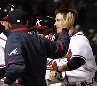 Kelly Johnson ends a very, very long night at Turner Field with his RBI single in the 10th inning.  (AP)