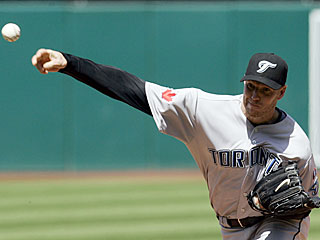 Roy Halladay improves to 2-0 by allowing one run in seven innings and outdueling Cliff Lee.  (AP)