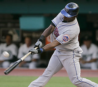 The Mets' Jose Reyes drives in three runs and hits his first home run of the season.  (AP)