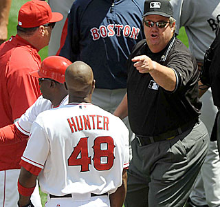 Crew chief Joe West makes sure Torii Hunter is aware he is being thrown out of the game.  (US Presswire)