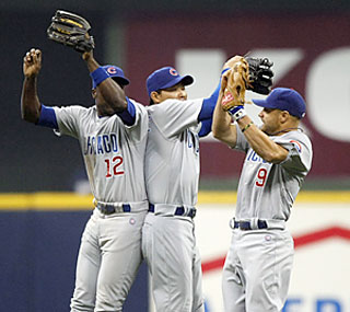 The Cubs' Alfonso Soriano, Kosuke Fukudome and Reed Johnson celebrate the nail-biting victory.  (AP)