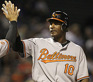 Adam Jones receives props following his two-run, tiebreaking homer in the top of the 10th inning.  (AP)