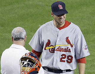 The Cards hope the game is the only thing they lose after starter Chris Carpenter leaves in pain.  (AP)