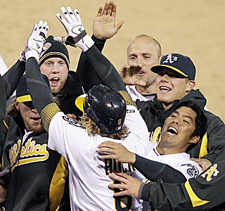 The Athletics finally can head back into the warmth of the clubhouse after Travis Buck's game winner.  (AP)