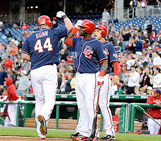 Adam Dunn rounds the bases after a three-run blast, one of four the Nationals hit.  (Getty Images)