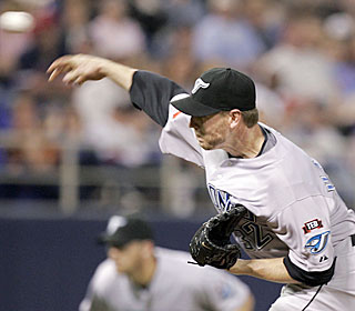 Roy Halladay continues to dominate the Twins, improving to 8-0 with a 2.77 ERA vs. Minnesota.  (AP)
