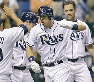 The Rays bring out the welcome wagon for Ben Zobrist after his pinch-hit grand slam in the sixth. (AP)