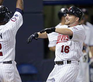 What a night for Jason Kubel. His grand slam highlights a Twins rally and completes the cycle. (AP)