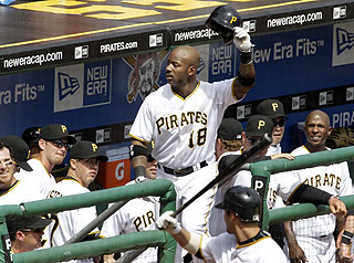 Pirates fans coax Craig Monroe out of the dugout for a curtain call after his seventh-inning homer. (AP)