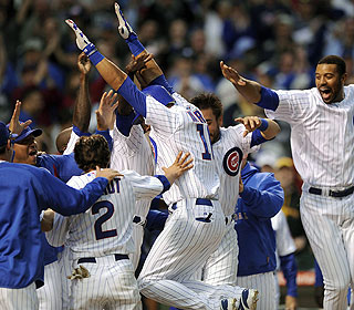 The Cubs are already partying as 11th-inning hero Aramis Ramirez leaps toward home plate. (AP)