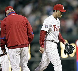 Brad Lidge leaves in dejection for the first time since Sept. 23, 2007, when he was with Houston. (AP)