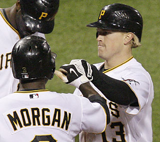 Nate McLouth torments the surging Marlins by providing four RBI in the Pirates' win.  (AP)