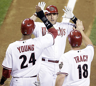 Miguel Montero finds a welcoming committee at home after he smacks a three-run shot in the fifth.  (AP)