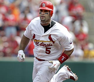Albert Pujols rounds the bases for one of his homers and finishes the day 3-for-4 with three RBI. (AP)