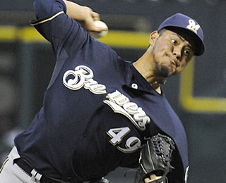 Yovani Gallardo strikes out seven and allows five hits, helping Milwaukee to three wins in a row. (AP)