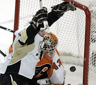 Goalie Martin Biron can only watch as Sidney Crosby scores the tying goal in the second period.  (AP)
