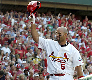 Albert Pujols takes a bow after clubbing his eighth career slam and driving in his 1,002nd run.  (AP)