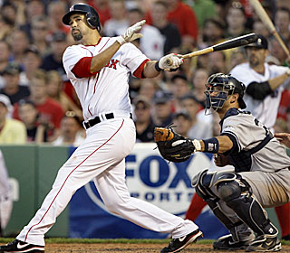 Mike Lowell beats up the rival Yanks with six RBI to lift the BoSox to their ninth straight win.
