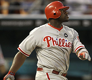 Phillies slugger Ryan Howard watches his third homer of the season leave the ballpark.  (AP)