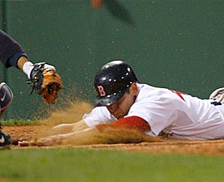 Jacoby Ellsbury gets in under Jorge Posada's tag for Boston's first steal of home since 1999.  (Getty Images)