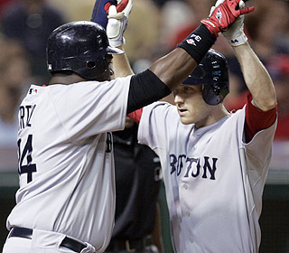 The Red Sox are smokin'. Big Papi is there to greet Jason Bay after he pushes Boston out front. (AP)