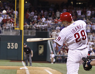 Raul Ibanez makes Joel Hanrahan pay in the eighth with a grand slam -- the Phils' second of the game.  (AP)
