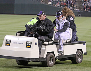 Brad Hawpe leaves the game with assistance in the sixth after suffering a scary neck injury.  (US Presswire)