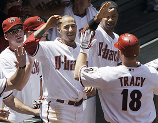 Chad Tracy helps the D-Backs run up the score as he provides three RBI in the blowout.  (AP)