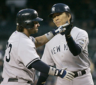 Nick Swisher and Hideki Matsui drive in a combined seven of the Yankees' eight runs.  (AP)