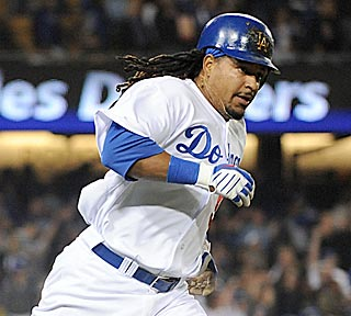 Manny Ramirez begins his tour of the bases after blasting a solo shot in the third inning.  (Getty Images)