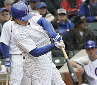 Ryan Theriot belts his first career grand slam, which gives the Cubs a 6-5 lead in the sixth.  (AP)