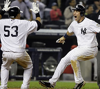 Mark Teixeira is pumped as the Yankees dramatically beat the Angels in the ninth inning.  (AP)