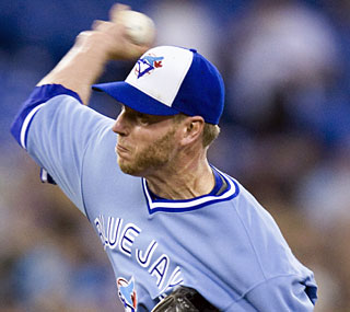 Roy Halladay joins Kansas City's Zack Greinke as the majors' only five-game winners.  (AP)