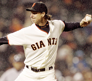 While the raindrops fall, Randy Johnson cruises through seven shutout innings. He is 2-2 this year. (AP)