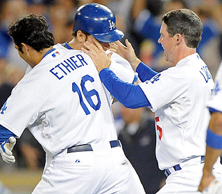 The Dodgers form a posse to welcome Russell Martin after he guts out the winning walk. (US Presswire)