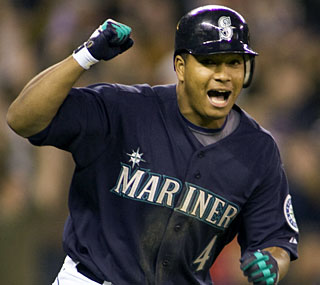 Jose Lopez wins a 14-pitch battle with Oakland's Russ Springer to complete the Mariners' comeback.  (AP)