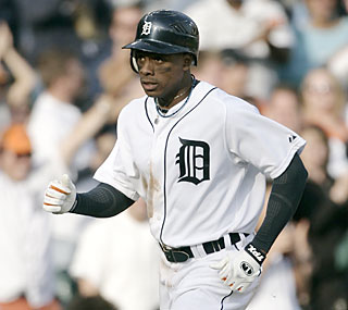 Curtis Granderson's two-run shot in the eighth inning helps his Tigers climb past the Indians.  (AP)
