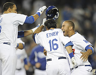 James Loney (left) and Matt Kemp (right) swarm Andre Ethier, who delivers the game-winning hit.  (AP)