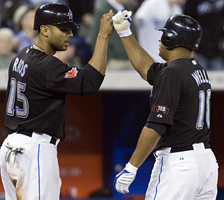 Alex Rios and Vernon Wells provide the power for the division-leading Blue Jays.  (AP)