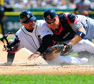 Placido Polanco is out at home after the tag by Indians catcher Kelly Shoppach.  (US Presswire)
