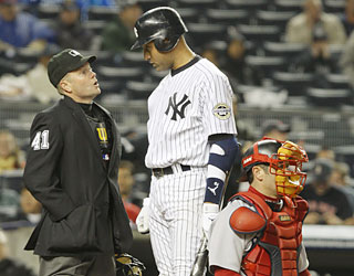 Derek Jeter argues a called third strike in the fourth, which results in skipper Joe Girardi getting tossed.  (AP)