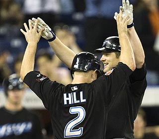 Aaron Hill and Adam Lind enjoy the seventh in which Lind hits a 3-run shot in the Jays' comeback.   (AP)