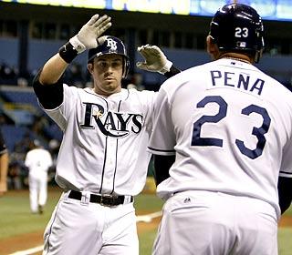 Evan Longoria -- celebrating with Carlos Pena -- adds three RBI to his major-league leading total (34).  (AP)